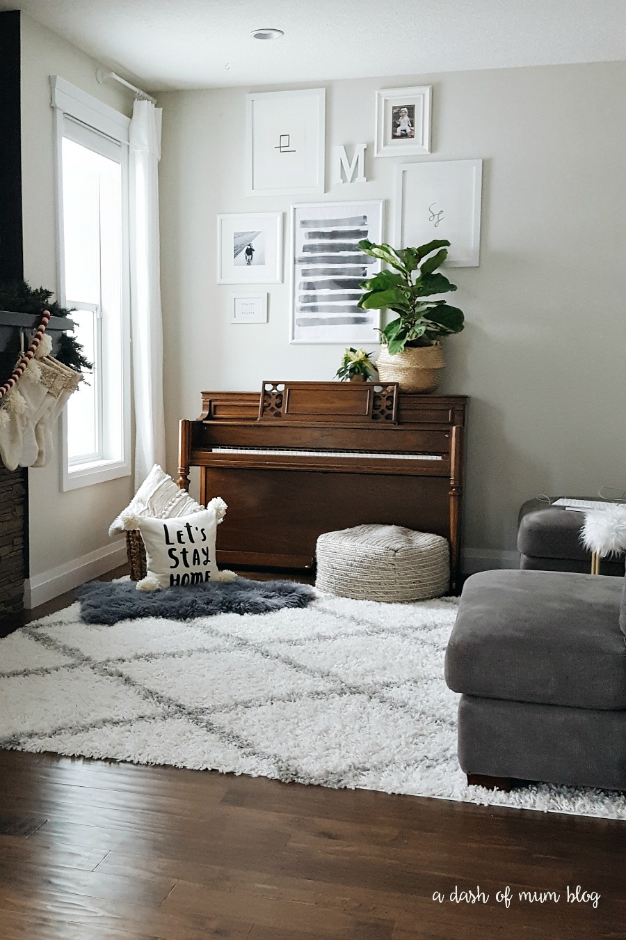 A White Shag Rug In The Living Room With A Baby Toddler